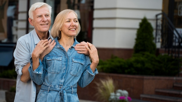 Embraced senior couple spending time together in the city
