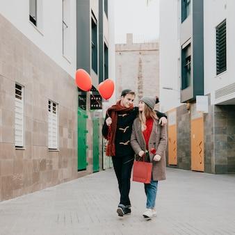 Embracing couple walking on date