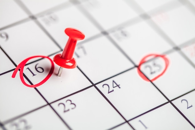 Embroidered  pin on a calendar on the 16th with selective focus