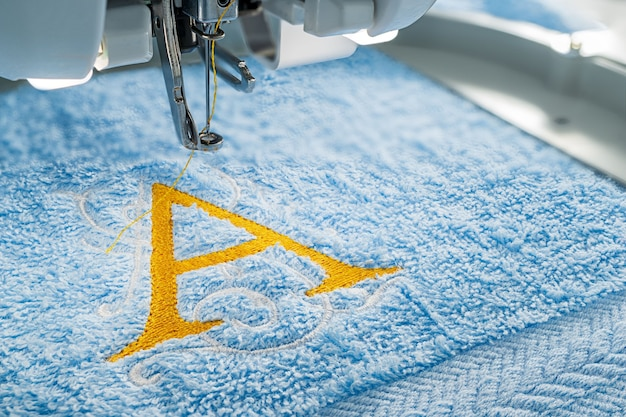 Embroidery machine and alphabet design on towel