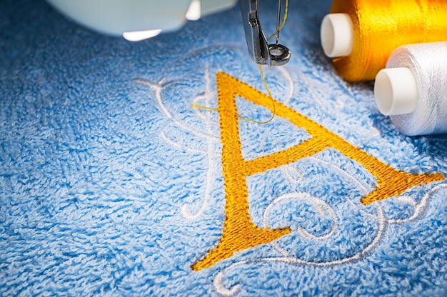 Embroidery machine and logo design on towel