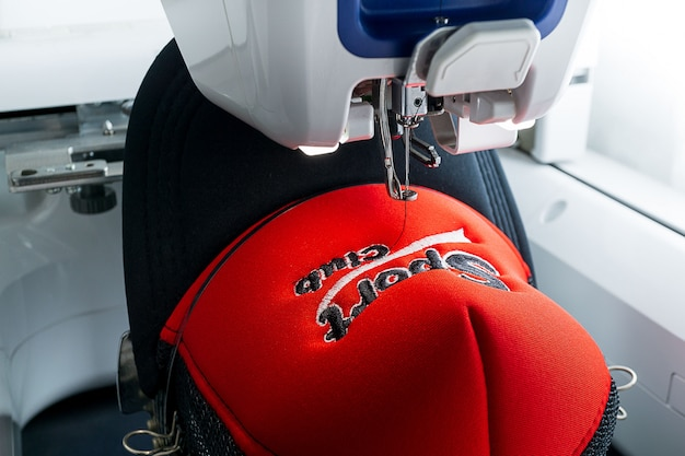 Embroidery machine and sport cap close up picture