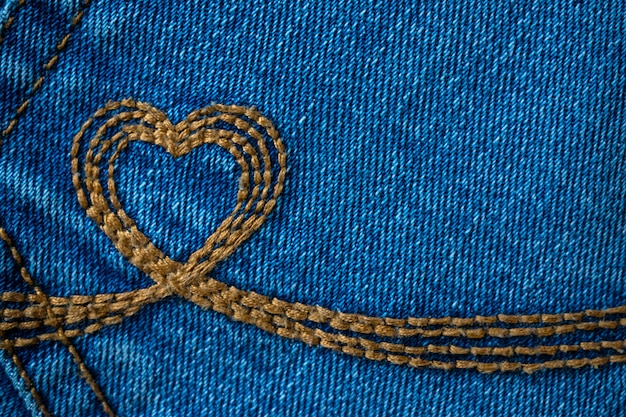 Embroidery in the shape of a heart on a denim background
