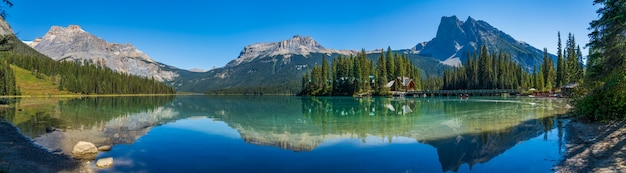 Emerald lake panorama view in summer sunny day