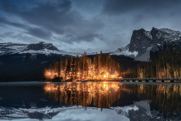 Emerald lake with wooden lodge in pine forest at yoho national park