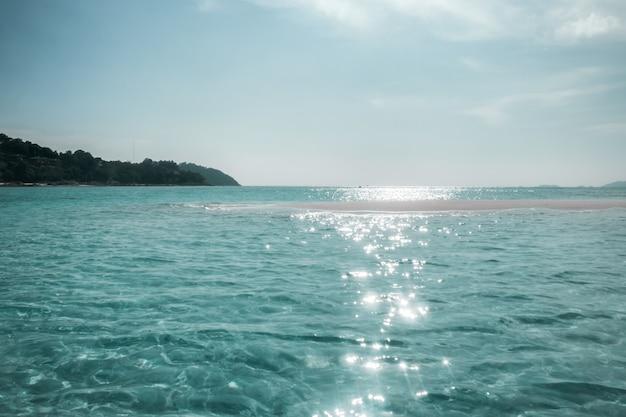 Emerald sea wave sunlight reflection