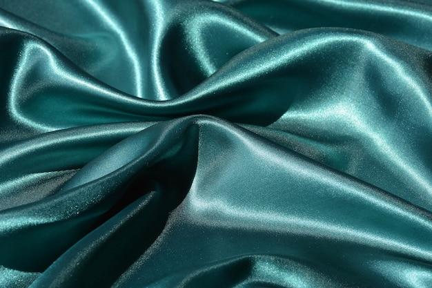 Emerald wavy silk background texture