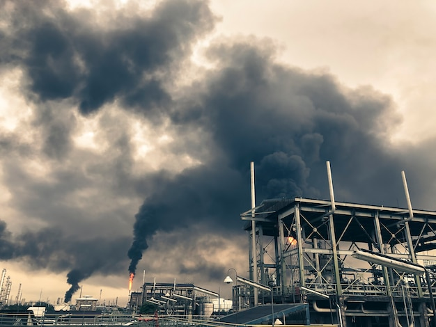 Emergency blow on flare stack petrochemical industry and global warning concept