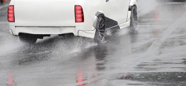 Emergency braking car on wet road