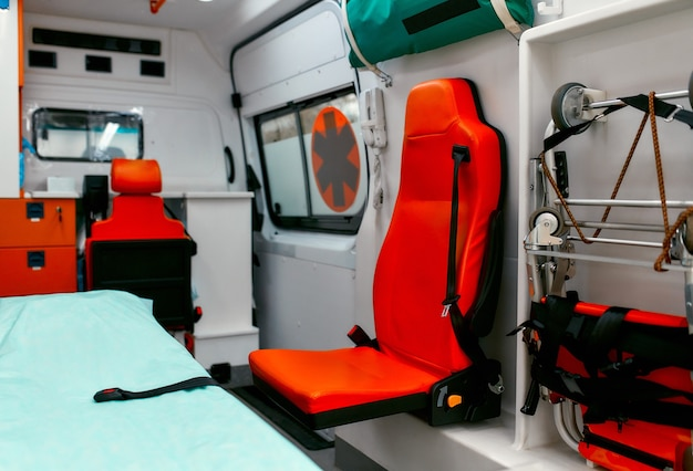 Emergency equipment and devices, ambulance interior details. inside an ambulance with medical equipment for helping patients before delivery to the hospital.