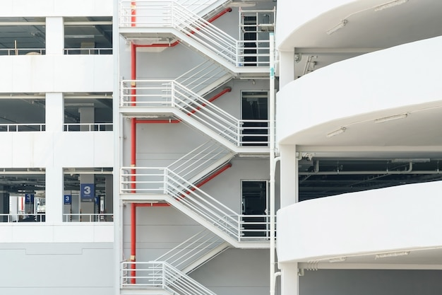 Emergency exit staircase with white walls. newly constructed parking garage