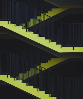 Emergency exit. yellow stairs of the parking lot
