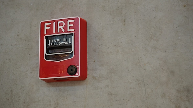 Emergency of fire alarm or alert or bell warning equipment in red color in the building for safety.
