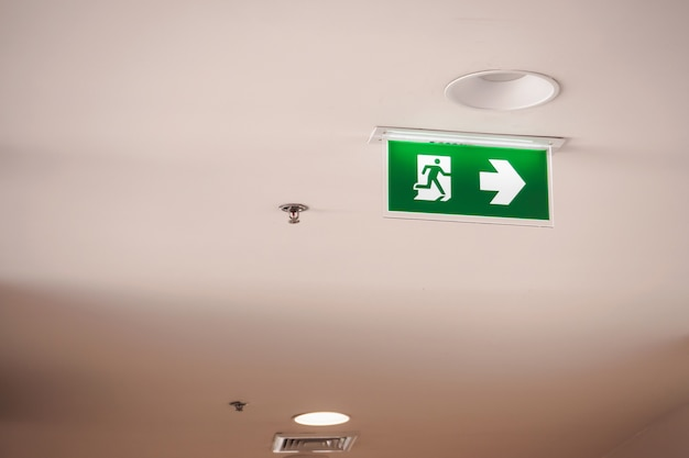 Emergency fire exit sign and fire sprinkler in large building