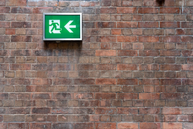 Emergency fire exit signs installed on the wall can clearly see safety concept fire alarm