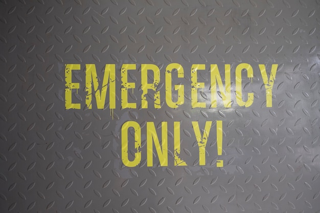 Emergency only sign on floor