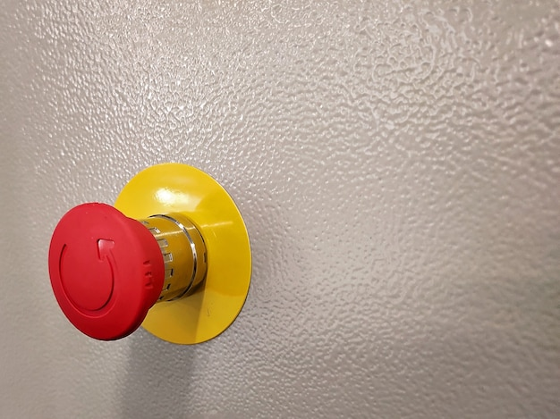 Emergency stop button, disaster protection. industrial concept. red button on table in dark low key background.
