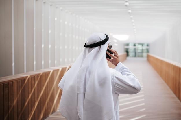 Emirati guy taking selfie in the urban city lifestyle downtown the heart of dubai.