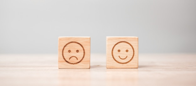 Emotion face symbol on wooden blocks