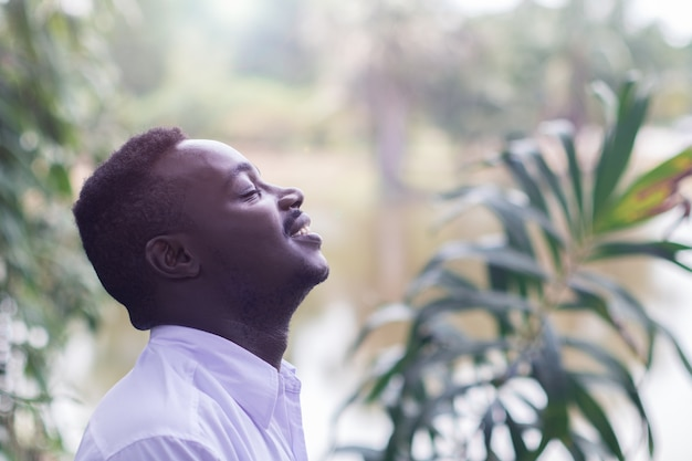 Emotional african  man laughing in wind
