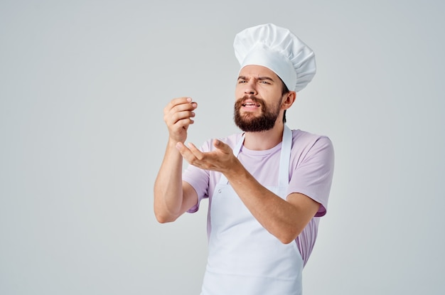 Emotional chef gesturing with his hands work in a restaurant industry. high quality photo
