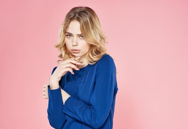 Emotional elegant woman wavy hair lifestyle studio pink background