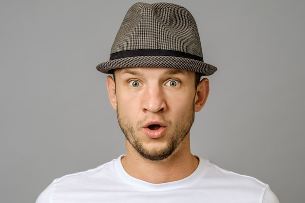 Emotional guy expresses surprised. facial expression