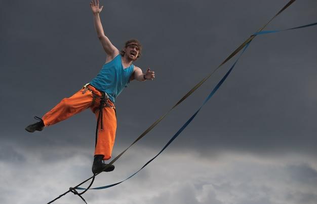Emotional highliner tightrope walker close up.