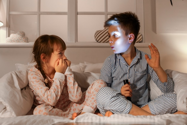Emotional little children in bedroom at home