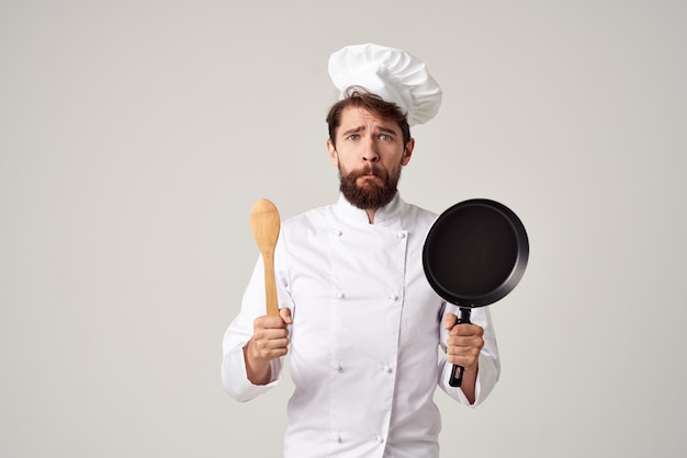 Emotional male chef frying pan cooking food professionals kitchen