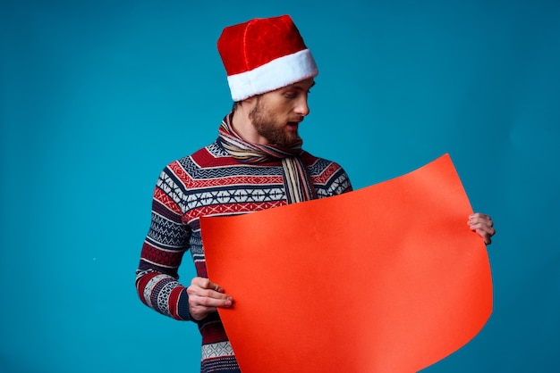 Emotional man in a christmas orange mockup poster blue background
