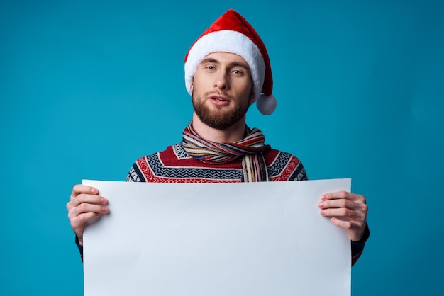 Emotional man in a christmas white mockup poster blue background