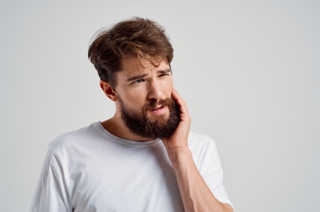 Emotional man medicine toothache and health problems isolated background