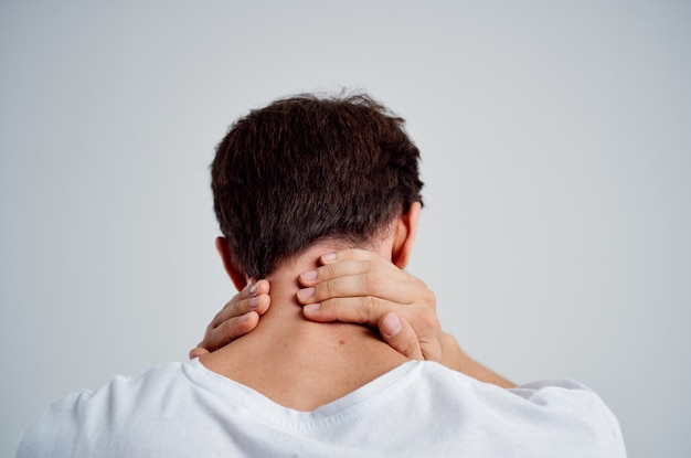 Emotional man pain in the neck health problems massage therapy isolated background
