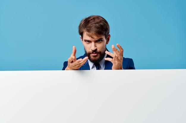 Emotional man white billboard advertising copyspace blue background