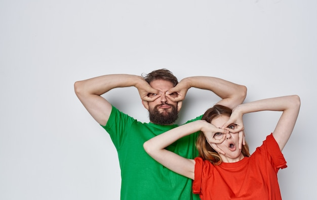 Emotional man and woman in colorful t-shirts family lifestyle studio. high quality photo