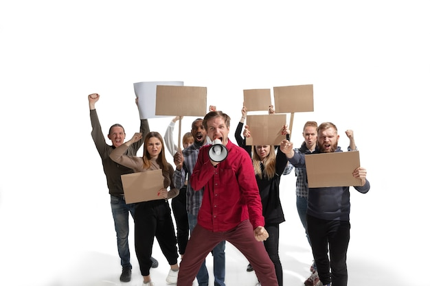 Emotional multicultural group of people screaming while holding blank placards on white
