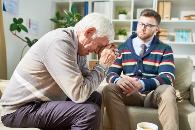 Emotional patient crying during psychotherapy session