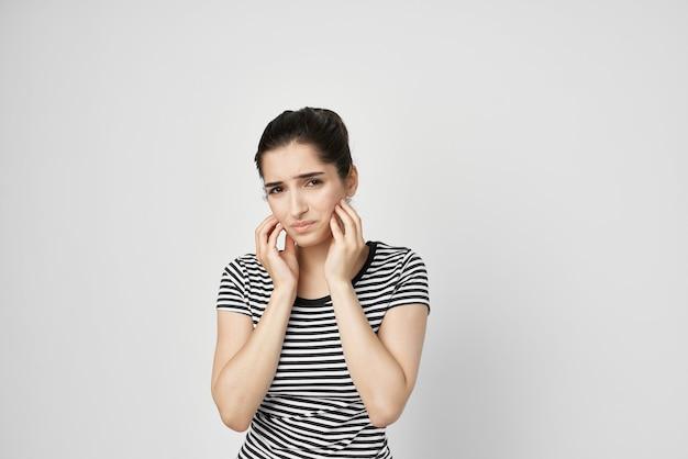 Emotional woman discomfort toothache dental treatment light background