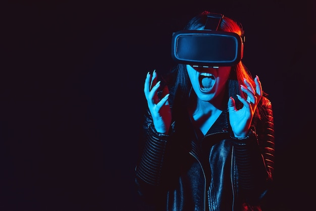 Emotional woman in modern glasses for immersive and virtual reality experience. modern augmented reality technologies