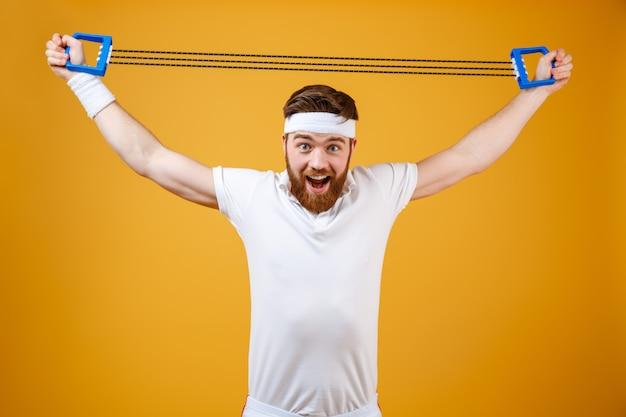 Emotional young sportsman make sport exercises