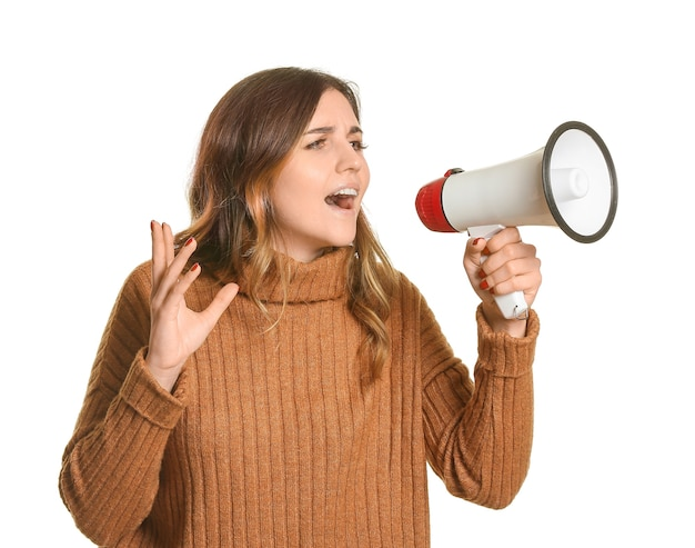 Emotional young woman with megaphone on white background