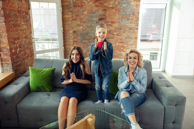 Emotions. mother, son and sister at home having fun. holidays, family, comfort, cozy concept, celebrating birthday. beautiful caucasian family. spending time together, playing, laughting greeting