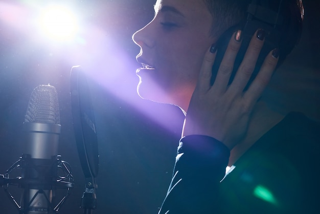 Emotive girl singing with microphone