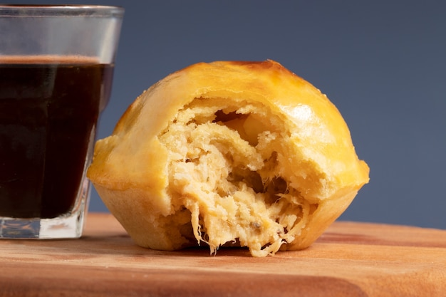 Empada of chicken, traditional brazilian snack with coffee.