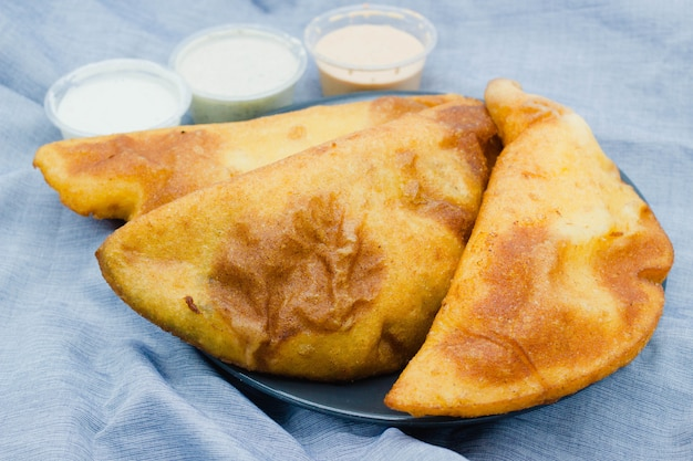 Empanadas venezolanas close-up. those empanadas are also eaten in colombia, usually for breakfast or lunch, and can be homemade or bought in a local street market