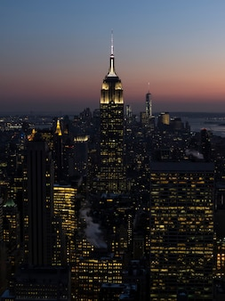 Empire state building in new york city skyline at sunset.