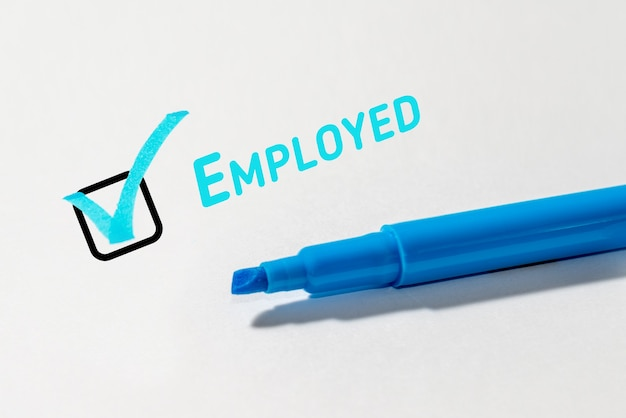 Employed. checkbox with a cross on white paper with a marker. checklist concept.