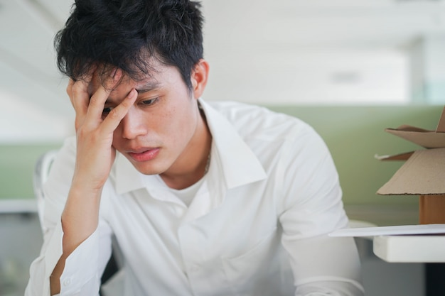 Employee asian man stressing about unemployment for global economic depression