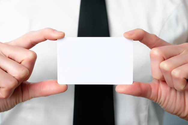 Employee of the bank offers a business card, close up